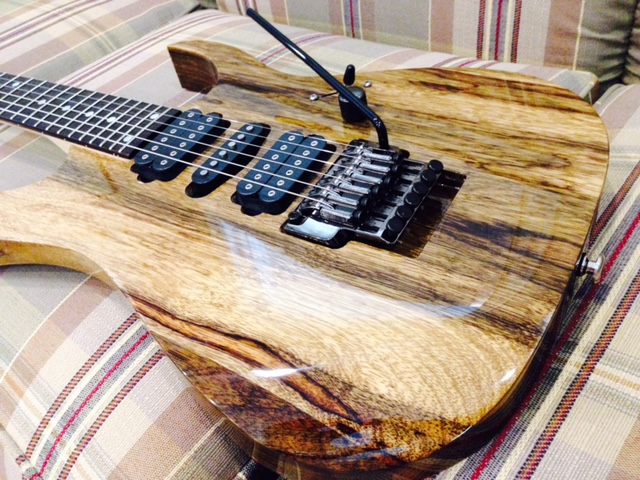 This One Is A Striped Body With Black Stain Then An Open Grain Finish The Neck From Ibanez RG Probably 570